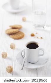cup of coffee, brown sugar and cookies
