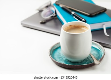 Cup of coffee with buisiness accessories on the background