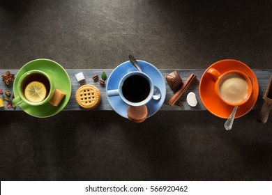 cup of coffee, cacao and tea on wooden background