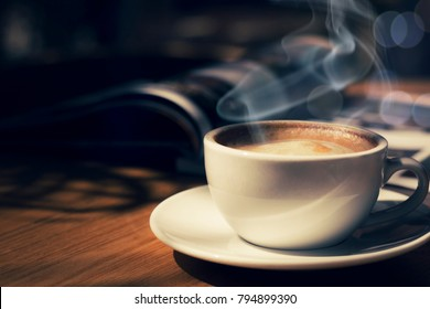 cup of coffee in cafee in dark tone and vintage