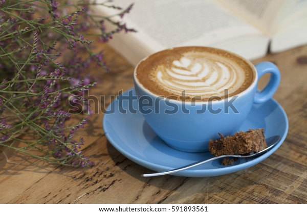 Cup of Coffee and Cake with a Book and some Flowers Cool Toned