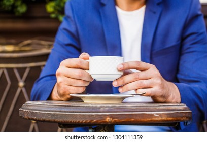 Cup of coffee. Cappuccino and black espresso coffe cup. Coffee drink. Close up of a man hands holding a hot coffe cups. Coffe time. Hand of man hold coffee or coffe cup at cafe in the morning.