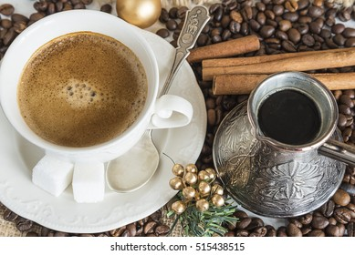Cup of coffee, cezve, coffee beans on sackcloth background. Top view close up