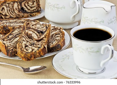 a cup of coffee and chocolate pastry
