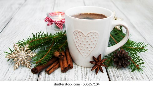 Cup of coffee and christmas decoration on the old wooden table