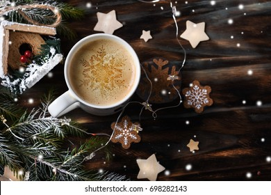 Cup of coffee with christmas decorations on dark wooden table.