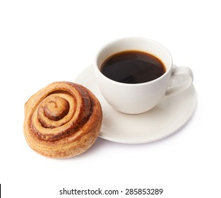 Cup of coffee and cinnamon roll bun pastry composition isolated over the white background