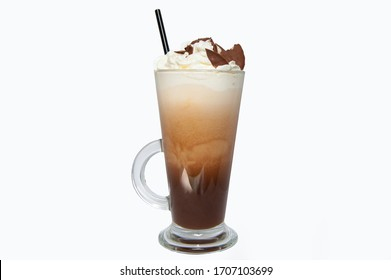 Cup of coffee in clear long glass. Isolated. Latte with ice cream and cookies and straw