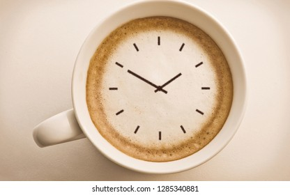 cup of coffee with clocks