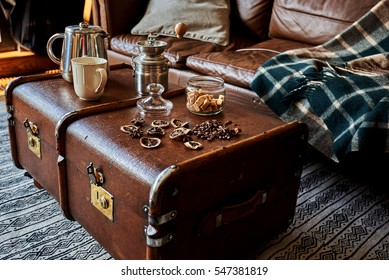 Cup of coffee, coffeepot and coffee beans on  vintage suitcase  design in colonial style.