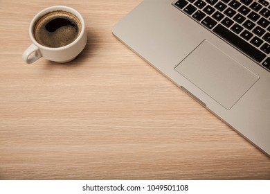 cup of coffee and a computer on the office desk