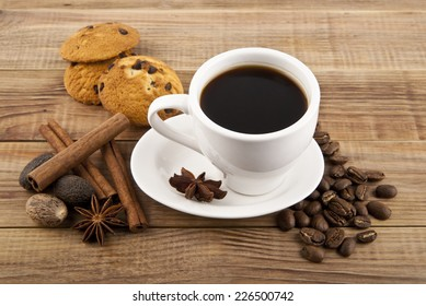 cup of coffee with a cookie on a white background