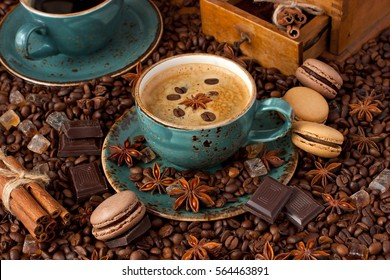 Cup of coffee with cookies and coffee beans