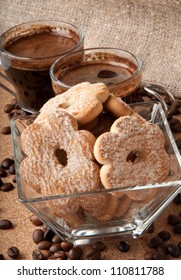 Cup of coffee and cookies in glass bowl