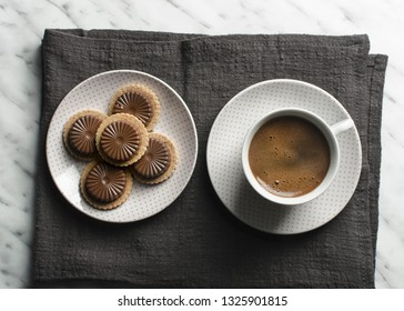 Cup of coffee with cookies  on marble table, top view