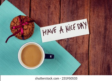 Cup of coffee and cookies on the table. Wishing a nice day. Pleasant surprise a friend or loved one. Note on the table next to the coffee and biscuits.