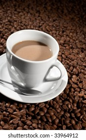 Cup with coffee, costing on coffee grain