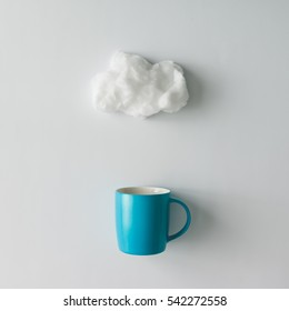 Cup of coffee with cotton wool cloud. Flat lay. Weather concept