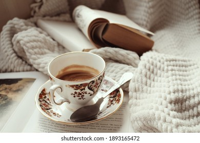 A cup of coffee in a cozy warm corner for reading