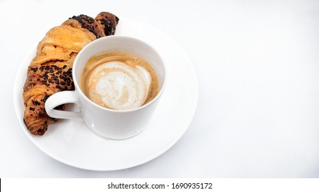 Cup of coffee and croissant on a white background
