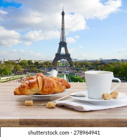 cup of coffee with croissant in Paris, France