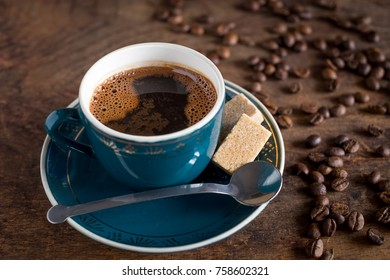 Cup of coffee with cube of sugar