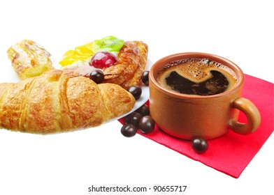 Cup of coffee and different sweet baking isolated on a white background