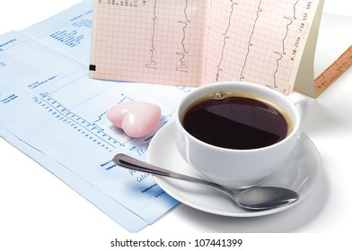 Cup of coffee, electrocardiogram and heart