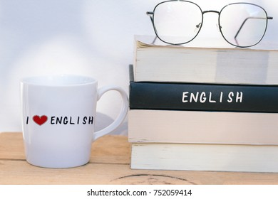 A cup of coffee and English textbooks - learning English language concept