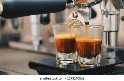 Cup of coffee espresso with espresso machine. Espresso on black scale. Vintage tone style