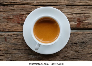 cup of coffee espresso on wood table, coffee top view