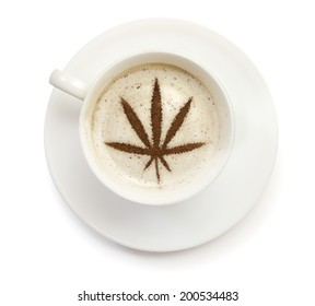 A cup of coffee with foam and powder in the shape of a marijuana leaf.(series)