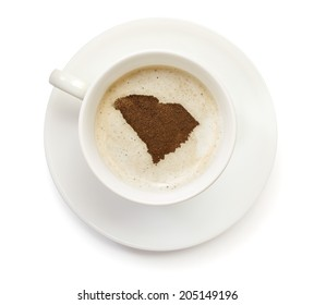 A cup of coffee with foam and powder in the shape of South Carolina.(series)