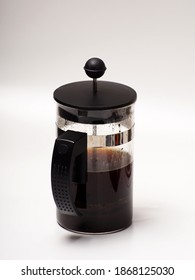 A cup of coffee and french press on a white isolated background