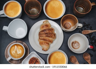 cup of coffee and Fresh baked croissant on old kitchen table. Top view with copyspace for your text.