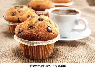 cup of coffee and fresh muffins