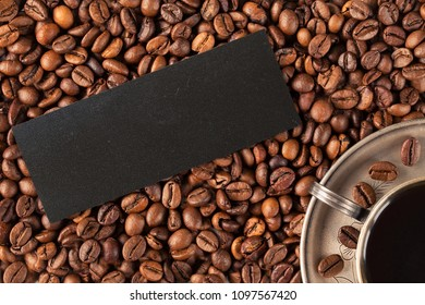 Cup of coffee with fresh roasted coffee beans. Top view with copyspace for your text. coffee beans background