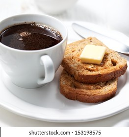 Cup of coffee and fresh toasts with butter