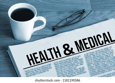 Cup of coffee, glasses and newspaper Health and Medical