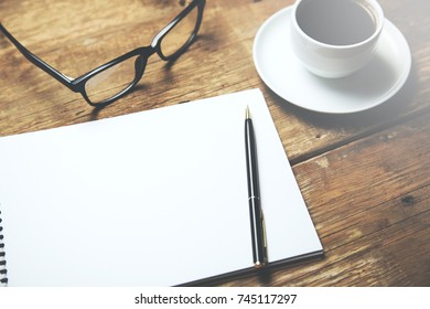 cup of coffee and glasses on page