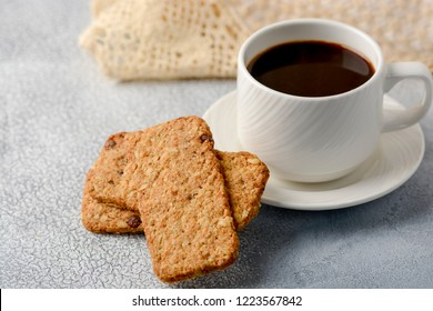 A cup of coffee with gluten-free cookies from cereals on the coffee table. Time have a bite. Copy space