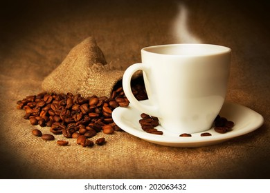 Cup of coffee and grains