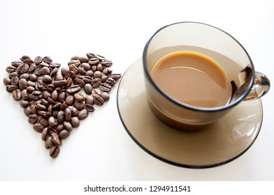 Cup of coffee with heart coffee beans