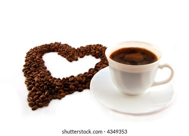 cup of coffee with heart of coffee beans.