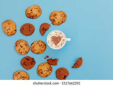 Cup of coffee with heart shape and cookies