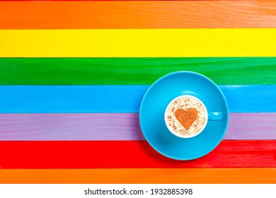 cup of coffee with heart shape on a color background.