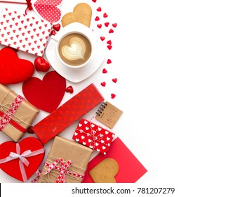 Cup of coffee and heart shaped cookies with gifts on white background. Happy valentine's day. Flat lay