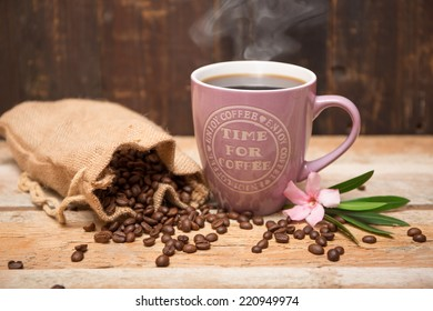 Cup of coffee with heart steaming