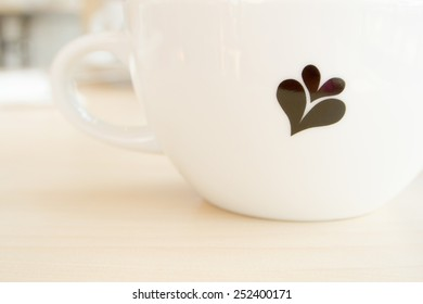 A cup of coffee with hearts