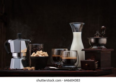 Cup of coffee and coffee ingredients on wooden table  .